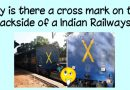 Why is there a cross mark on the backside of an Indian Railways